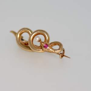 A Victorian Ruby And Pearl Snake Brooch, Circa.1875