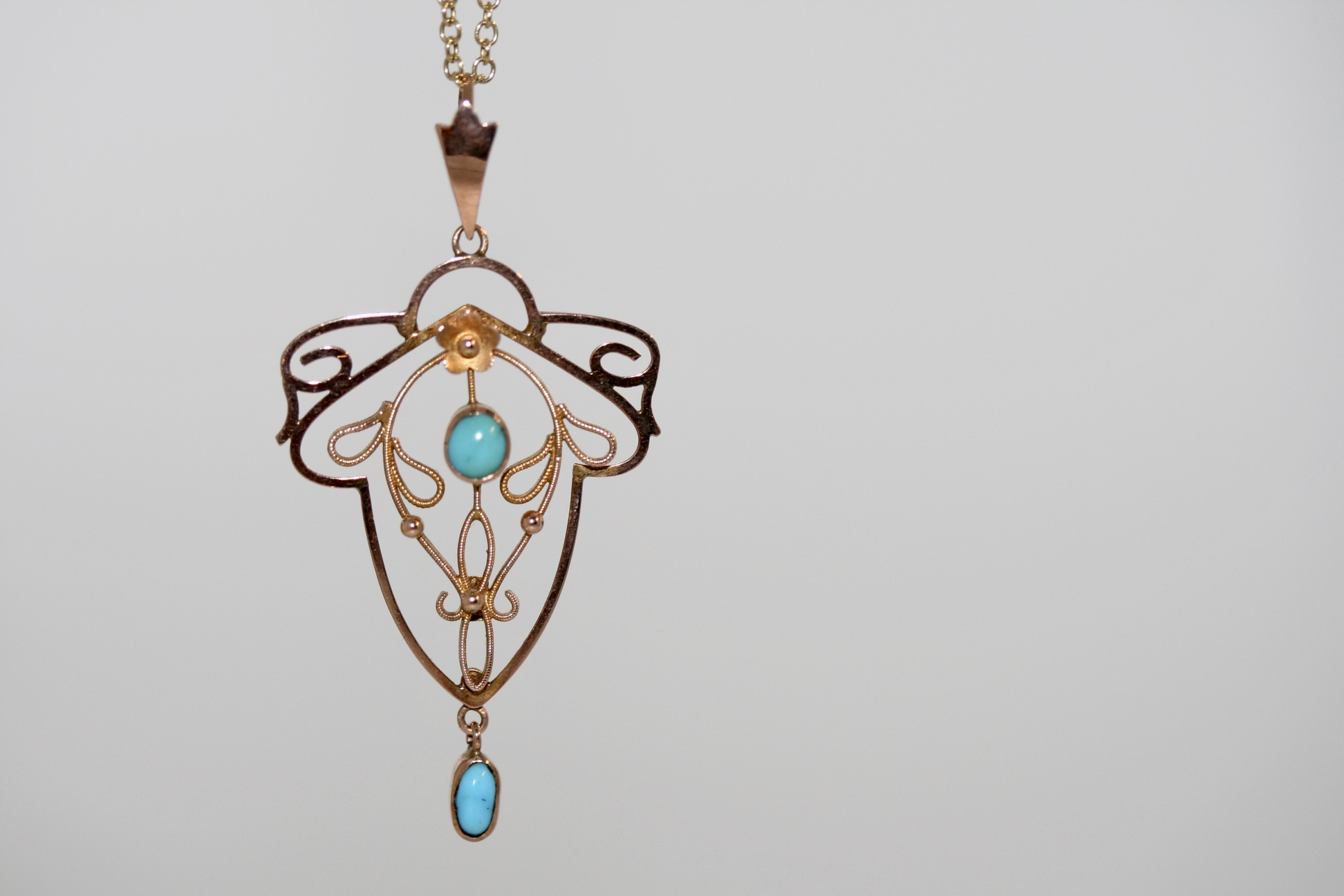 An Art Nouveau 9ct Gold And Turquoise Pendant