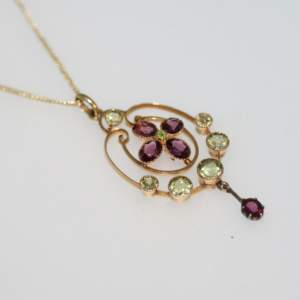 An Edwardian 15ct Gold Peridot And Garnet Pendant, Circa 1900