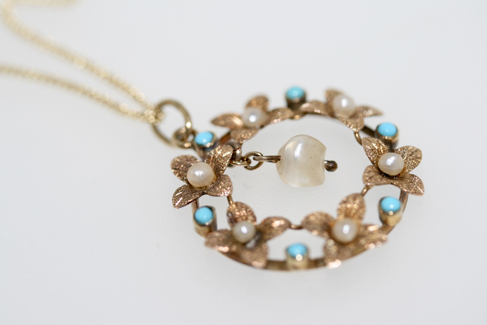 An Edwardian Turquoise And Pearl Posy Pendant