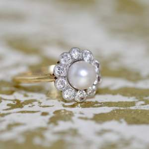 An Edwardian Pearl And Diamond Cluster Ring
