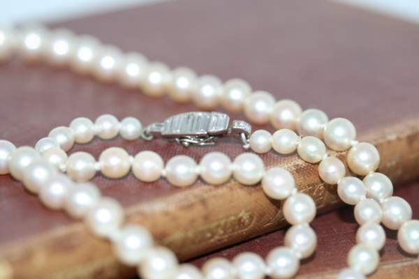An Art Deco Cultured Pearl And Diamond Necklace, Circa 1930